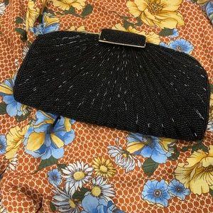 Black hand beaded dressy handbag.